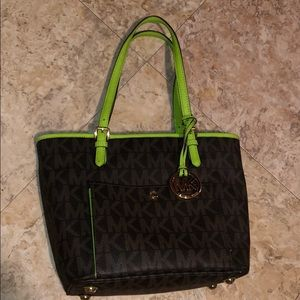 Michael Kors purse with lime green outline